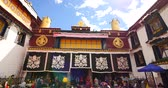 roof : Pilgrams Praying In Front Of The Jokhang Temple In Lhasa,Tibet. Stock Footage