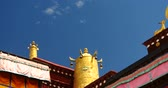 roof : closeup of The Jokhang Temple In Lhasa,Tibet,white clouds in blue sky. Stock Footage