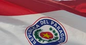 база : Paraguay flag is fluttering in wind.