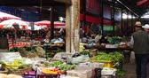 хорошее здоровье : 4k variety of food & Life items in large outdoor trade market Shangri-La,china,busy crowd on the marketplace.