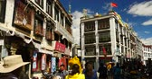 imaginar : 4k tibetan & tourist walking on famous barkhor street in lhasa,tibet,butter store.