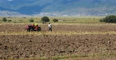 shangrila : tibetan people use farm tractor Arable land in shangrila yunnan,china.