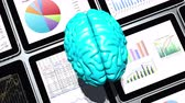 computação gráfica : rotating brain on the top of Mobile devices,finance pie charts & stock trend diagrams in the tablet,artificial intelligence. Stock Footage