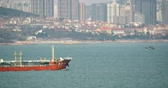 usa : 4k tanker ship Through urban building background,QingDao China. Stock Footage