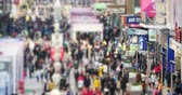 businness : 4k timelapse Huge Crowd Of blur People walking on china business street,QingDao. Stock Footage