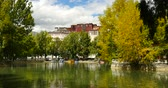 spirit : 4k Potala reflection on lake in Lhasa park,Tibet.lake with tree in autumn.. Stock Footage