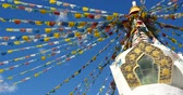shangrila : 4k buddhist white stupa & flying prayer flags with blue sky background,shangrila yunnan,china.