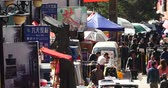 peddler : 4k The busy resident crowd walking on the market in Shangri-La street,china. Stock Footage