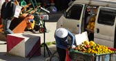 peddler : 4k Fruit stand & grocery store in Shangri-La street,The busy crowd,china.
