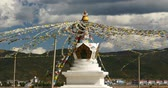 shangrila : 4k buddhist white stupa & flying prayer flags with clouds background,shangrila yunnan,china. Stock Footage