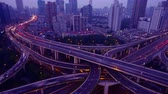 yanan : 4k video,Timelapse of freeway busy city rush hour heavy traffic jam highway Shanghai from day to night,Yanan East Road Overpass interchange,the light trails of traffic with super long exposures for each frame,Brightly lit urban morden building.