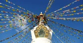 shangrila : 4k buddhist white stupa and flying prayer flags with blue sky background,shangrila yunnan,china.