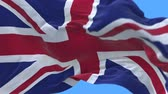база : 4k flag of the United Kingdom Of Great Britain and Northern Ireland (Union Jack) slow waving with visible wrinkles.A fully digital rendering,The animation loops at 20 seconds.flag 3D animation with alpha channel included.
