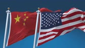 democrático : seamless Usa And China Flags with blue sky background,A fully digital rendering,The animation loops at 20 seconds.flag 3D animation with alpha channel included.