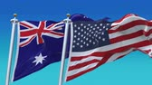 au : 4k Seamless United States of America And Australia Flags with blue sky background,A fully digital rendering,The flag 3D animation loops at 20 seconds,USA AUS AU. Stock Footage