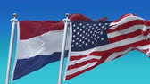 eleição : 4k Seamless United States of America And Netherlands Holland Flags with blue sky background,A fully digNLl rendering,The flag 3D animation loops at 20 seconds,USA NL.