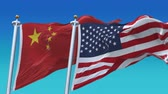silahlı : 4k United States of America and China Flags with blue sky background.