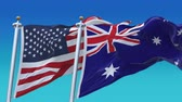 au : 4k United States of America And Australia Flags with blue sky background. Stock Footage