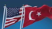 democrático : 4k Seamless United States of America And Turkey Flags with blue sky background,A fully digital rendering,The flag 3D animation loops at 20 seconds,USA US TUR TR.