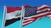 4k Seamless United States of America And Iraq Flags with blue sky background,A fully digital rendering,The flag 3D animation loops at 20 seconds,USA US IRQ IQ.