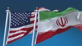 4k Seamless United States of America And Iran Flags with blue sky background,A fully digital rendering,The flag 3D animation loops at 20 seconds,USA US IRI IR.