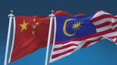 4k Seamless Malaysia and China Flags with blue sky background, A fully digital rendering, The animation loops at 20 seconds