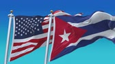 4k Seamless United States of America And Cuba Flags with blue sky background,A fully digital rendering,The flag 3D animation loops at 20 seconds