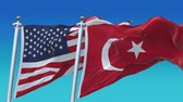 4k Seamless United States of America And Turkey Flags with blue sky background,A fully digital rendering,The flag 3D animation loops at 20 seconds
