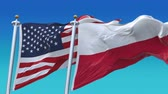 4k Seamless United States of America And Poland Flags with blue sky background,A fully digital rendering,The flag 3D animation loops at 20 seconds