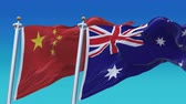 au : 4k Seamless Australia and China Flags with blue sky background, A fully digital rendering, The animation loops at 20 seconds