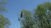 slackline : Tightrope walking on a high rope stretched