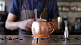 classic : Barman is decorated with a cocktail in a copper bowl Stock Footage