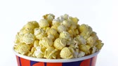смаковать : Popcorn with taste of bacon rotates on a white background. Close up shot Стоковые видеозаписи