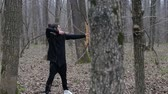 bowman : Man shoot with a bow in the forest Stock Footage