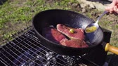 kara tahta : Fresh steak meat preparing on a pan outdoor Stok Video