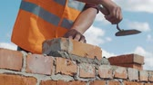 bricklayer : Close-up shot of Bricklayer builds wall Stock Footage