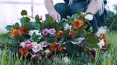hortênsia : Woman makes a bouquet in the rose garden