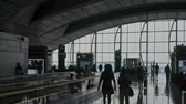 saco : Hongkong, China - August 2019: silhouttes of people with baggage walking in airport terminal hall. blurred defocused shot of passengers sitting on seats. concept panoramic window, luggage, suitcase. lounge room Stock Footage
