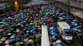 menschenmenge : Hong Kong, China - August, 2019: Aerial view of protesting people and police car driving during demonstration in city. Adult men and woman with umbrellas walking along street, attend at civil rally in support of five demands in Hong Kong. Concept: urban,  Videos