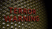 extremism : Wall of rounded Plates with the Text Terror Warning, with a Camera Move from the Side to a Front View. The Plates are in Black-Yellow and the Text is in Red