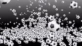 Hundreds of soccer balls falling to the ground and bounce.