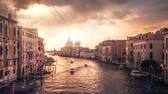 A slow motion video of Venice in Italy with some dramatic skies and sun beams.