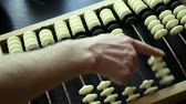 laborious : hand make calculations on vintage abacus counting