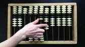 laborious : hand make calculations on vintage wooden abacus counting