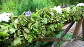 green solstice wedding decoration on house terrace handrails oak leaves and flowers camera sliding above