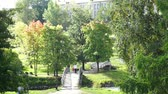 pram : PETROZAVODSK, RUSSIA - SEPTEMBER,11: Woman walking with kid in a park on September 11, 2013, Petrozavodsk, Russia. Park near Lososinka river is popular place to walk in Petrozavodsk Stock Footage