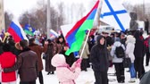 independence : PETROZAVODSK, RUSSIA, MARCH 16, 2014: Russian people protest against war in Crimea and support democracy in Crimea. Girl with the flag of the Republic of Karelia. Today Crimea votes in referendum on whether to rejoin Russia or stay with Ukraine.