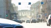 junção : SAINT PETERSBURG, RUSSIA - MARCH 18, 2015: City view at roadway near Central Post Office with heavy day traffic in Counter Sunlight
