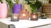 фитиль : Bright fire in a glass candlestick Стоковые видеозаписи