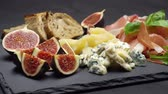 capers : traditional cheese and meat plate wth parma, parmesan and figs Stock Footage